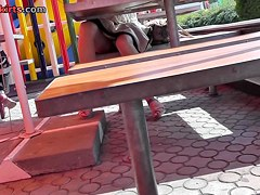 Sexy sitting upskirt in a street cafe