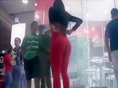 Hot model in tight red suit mingles with the crowd at the club