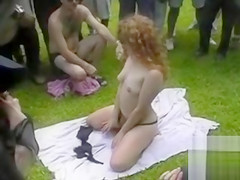 Ginger girl strips down and pleasures her pussy in front of people