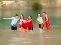 Friends swim in the lake in their underwear