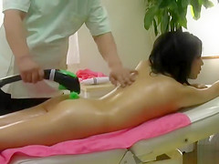 Slim Asian doll receives a full body massage