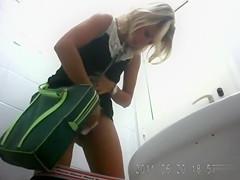 Cute blonde in a dress takes a quick piss