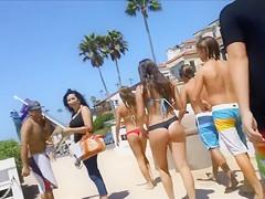 Beautiful lass with a big ass wears a flimsy bikini