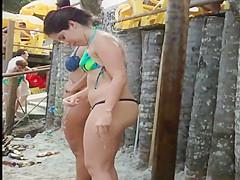 Good looking chick wears a flimsy bikini to the beach