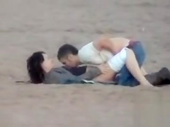German couple makes love on the deserted beach