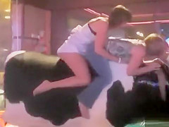 Sweet thing reveals her round butt while riding on a bull