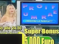 Smoking hot Italian blonde teases with her tits live on TV