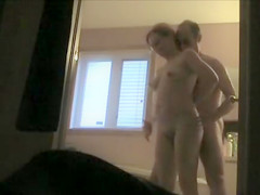 Fooling around with his wife in the bathroom
