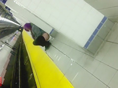Wicked purple-haired babe makes water at the subway