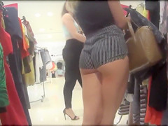 Smoking hot blonde has lower part of her big ass revealed