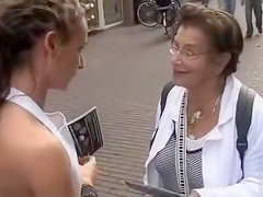 Sales promoters have visible asses while interviewing strangers