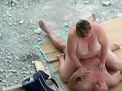 Chubby mommy plays with her friend's penis