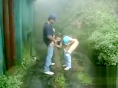 Couple fucks outdoors on a stormy day