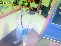 Blonde woman pisses right in front of the receptionist's desk