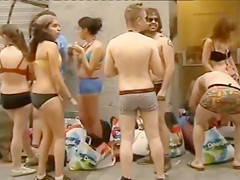 Spain students wearing only underwear wait in front of the shop for it to open