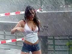Stunning Latina babe has fun dancing in the rain