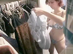 Busty housewife checking out her wardrobe