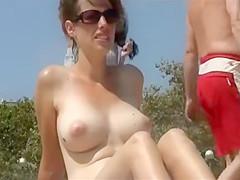Stunning brunette exposes her bombastic boobs