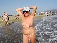 My naughty wife takes a naked walk at the coast