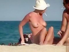 Nudist couple getting some color onto their private parts