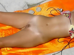 Ukrainian nudist girl sunbathes with her hirsute twat and tits out