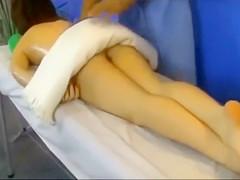 Stunning brunette model receives a buttock massage