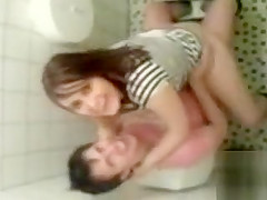 College girl fucked hard in a restroom stall