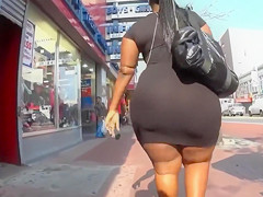 Ebony BBW with a huge booty walks down the street