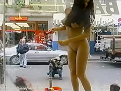 Young flexible looker poses completely naked in the store