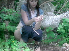 Desperate brunette gets recorded relieving herself in the woods