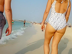 Tight swimsuit exposes the lusty curves of a delicious woman