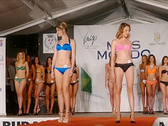 Beautiful models move on the catwalk in flimsy bikinis
