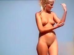 Ravishing angel walks around the beach in the nude