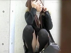 Long-haired Japanese schoolgirl pees herself a little in public