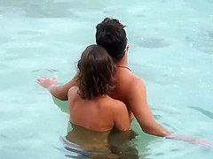 Topless GF captured when giving handjob in the water