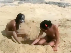 Nude beach foreplay and lesbian licking with brunettes