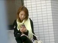Japanese girl sexy upskirt on public sidewalk