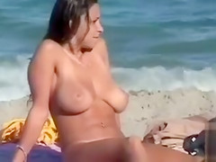 Beautiful big tits on the nudist beach