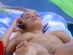 Gorgeous hottie rubs oil into huge tits