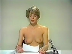 Perky tits blonde reads the news topless