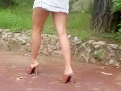 Leggy babe in heels and a dress filmed walking