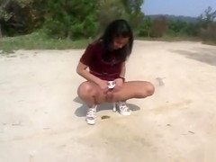 Naughty girlfriends compete to see who can piss the farthest distance