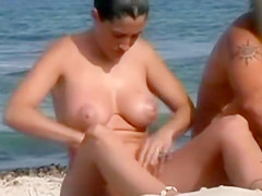 Nude beach compilation set to music has lots of pussies