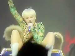 Miley Cyrus sings in a skimpy thong leotard