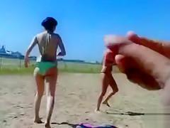 German pervert jerks off to women on topless beach