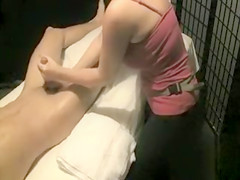 Talented masseuse masturbates her horny male client