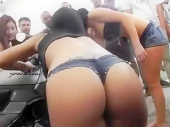 Four babes with hot asses wash bikes for the guys