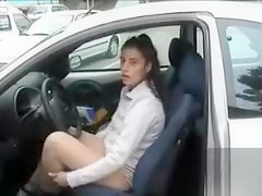 Female public masturbation in a crowded parking lot