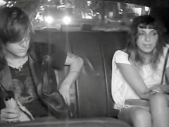 Naughty students fool around in the back of a taxi