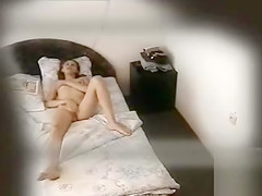 Skinny girl undresses and masturbates before bed